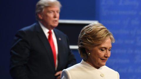 Democratic nominee Hillary Clinton (R) and Republican nominee Donald Trump walk off the stage after the final presidential debate at the Thomas & Mack Center on the campus of the University of Las Vegas in Las Vegas, Nevada on October 19, 2016. / AFP PHOTO / Robyn Beck