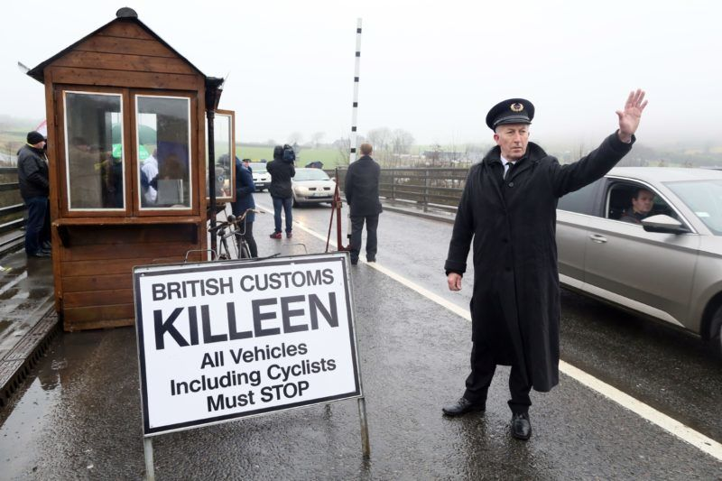 Demonstrators dressed as custom officials set up a mock customs checkpoint at the border crossing in Killeen, near Dundalk to protest against the potential introduction of border checks following the decision by the UK to leave the EU on February 18, 2017.    / AFP PHOTO / Paul FAITH