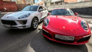 5618686 27.08.2018 A Porsche Carrera 4s, right, and Porsche Macan of the Moscow carsharing service Yandex.Drive, at a parking lot in Moscow. Twelve cars were purchased for the per-minute rental service, with one minute costing from 20 to 60 rubles. Anton Denisov / Sputnik