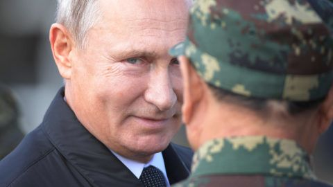 5636639 13.09.2018 Russian President Vladimir Putin talks to Chinese Defence Minister Wei Fenghe as he arrives to review troops during Vostok-2018 (East-2018) military drills at the Tsugol training ground, Zabaikalsky Krai region, Russia, September 13, 2018. Vostok-2018 (East-2018) military drills are the biggest since a Soviet military exercise Zapad-81 (West-81) that took place in 1981. Sergey Guneev / Sputnik