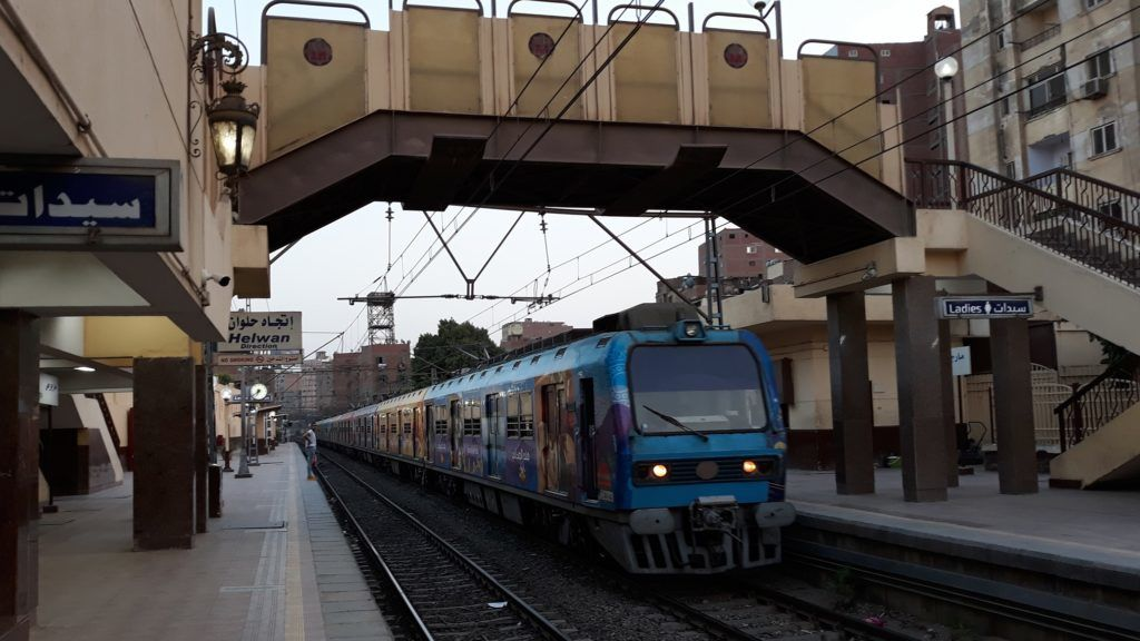A train drives from one station to another in the Egyptian capital, Cairo, on May 28, 2018. While Egypt's economy is displaying the green shoots of recovery, citizens are imbibing a bitter cocktail of water, fuel, electricity and metro cost hikes. / AFP PHOTO / KHALED DESOUKI