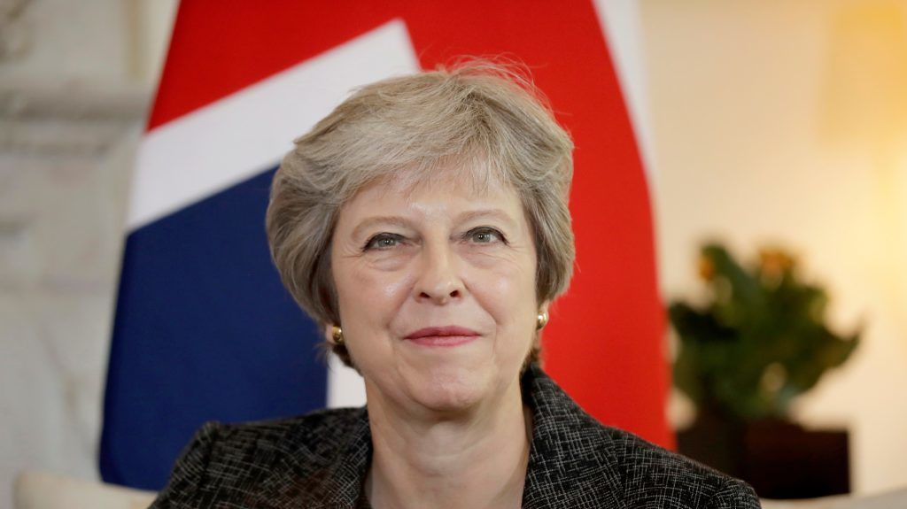 (FILES) In this file photo taken on July 24, 2018 Britain's Prime Minister Theresa May reacts during her meeting with the Emir of Qatar, Sheikh Tamim Bin Hamad al-Thani, at 10 Downing Street in London. Prime Minister Theresa May will make a three-nation visit to Africa this week, her first to the continent since becoming British leader in 2016, aimed at boosting post-Brexit trade ties. / AFP PHOTO / POOL / Matt Dunham
