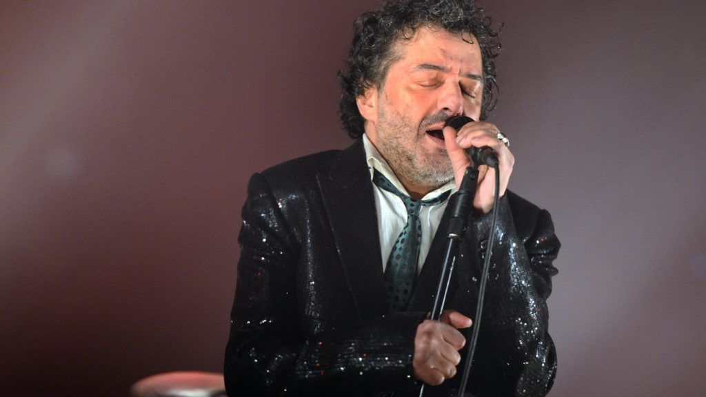 """(FILES) In this file photo taken on December 7, 2012 Algerian singer Rachid Taha performs on stage during the 34th Trans Musicales Music Festival in Rennes, western France.  Singer Rachid Taha, who had covered the song """"Douce France"""", died according to the family on September 12, 2018. / AFP PHOTO / THOMAS BREGARDIS"""