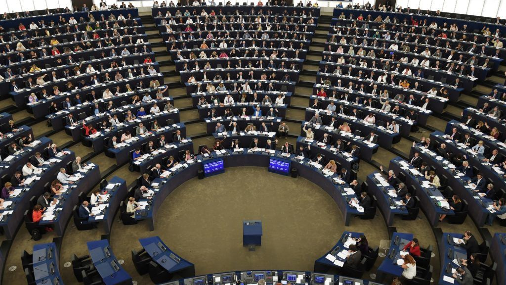 Members of the European Parliament take part in a voting session during a plenary session at the European Parliament on September 12, 2018 in Strasbourg, eastern France. / AFP PHOTO / FREDERICK FLORIN