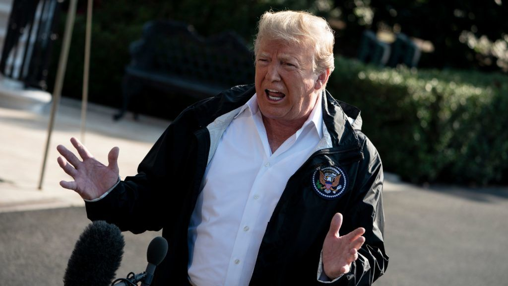 """US President Donald Trump speaks to the press before boarding Marine One on the South Lawn of the White House September 19, 2018 in Washington, DC. US President Donald Trump said Wednesday it would be """"unfortunate"""" if the woman who has accused his nominee for the Supreme Court of a sexual assault failed to show up at a Senate hearing into the allegations.   / AFP PHOTO / Brendan Smialowski"""