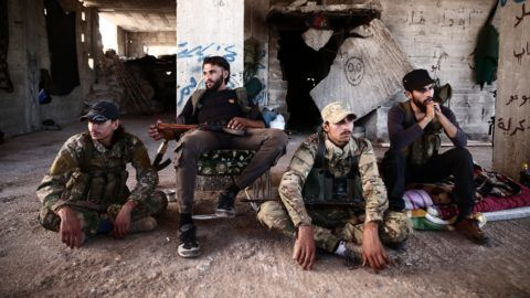 Fighters from the Nureddine al-Zinki unit, a moderate Syrian opposition faction affiliated with the Muslim Brotherhood and made up of former Syrian Free Army fighters, rest in a position in a rebel-held part of Aleppo province that lies directly east of the main opposition bastion in Idlib on September 23, 2018. Under a Russia-Turkey agreement announced recently, a demilitarised zone is to be set up around Idlib, one of the country's last major jihadist and rebel bastions on the border with Turkey. / AFP PHOTO / Nazeer AL-KHATIB