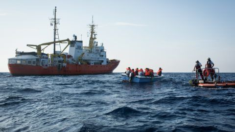 """A handout photo released on September 24, 2018 by SOS Mediterranee shows migrants being rescued by the Aquarius rescue ship run by non-governmental organisations (NGO) """"SOS Mediterranee"""" and """"Medecins Sans Frontieres"""" (Doctors without Borders) in the search and rescue zone off the coast of Libya, in the Mediterranean Sea, on September 20, 2018.   SOS Mediterranee and Doctors without Borders (MSF) which operate the Aquarius rescue missions lambasted Italy for pressuring Panama into revoking its flag, warning the move deals a """"major blow"""" to humanitarian missions off Europe's southern coasts.   / AFP PHOTO / SOS MEDITERRANEE / Maud VEITH / RESTRICTED TO EDITORIAL USE - MANDATORY CREDIT """"AFP PHOTO / SOS MEDITERRANEE / Maud VEITH"""" - NO MARKETING NO ADVERTISING CAMPAIGNS - DISTRIBUTED AS A SERVICE TO CLIENTS"""