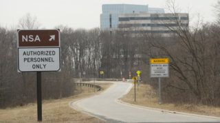 An entrance to the National Security Agency (NSA) headquarters is seen after a shooting incident at the visitor's entrance of the facility in Fort Meade, Maryland, February 14, 2018. Shots were fired early Wednesday at the ultra-secret National Security Agency, the US electronic spying agency outside Washington, leaving one person injured, officials said. Aerial footage of the scene from NBC News showed a black SUV with numerous bullet holes in its windshield crashed into concrete barriers at the main entrance to the NSA's headquarters in Fort Meade, Maryland.  / AFP PHOTO / SAUL LOEB