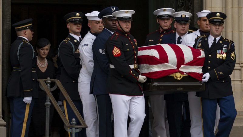 A Military Honor Guard carries the casket of late Senator John McCain, Republican of Arizona, followed by his family after a funeral service at the Washington National Cathedral in Washington, DC on September 1, 2018.  Credit: Alex Edelman / CNP   usage worldwide