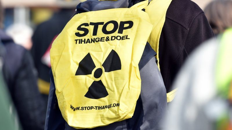 """30 March 2018, Germany, Gronau: A participant in the Easter March 2018 wearing the slogan """"Stop Tihange and Doel"""" and protesting against nuclear power and nuclear weapons before the Urenco uranium enrichment facility. Photo: Caroline Seidel/dpa"""
