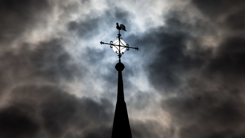 07 July 2018, Germany, Glandorf: The weathercock and the cross atop the tower of the Roman Catholic church of St. Johannis People from all over Germany are expected to take part in the 2-day 166th Telgte Pilgrimage from Osnabrueck to Telgte. Photo: Friso Gentsch/dpa