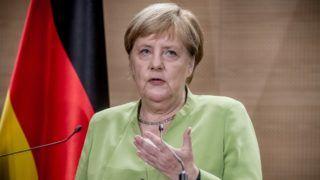 17 September 2018, Algeria, Algier: German Chancellor Angela Merkel (CDU) attending a press conference at the International Conference Centre Abdelalif Rahal. Photo: Michael Kappeler/dpa