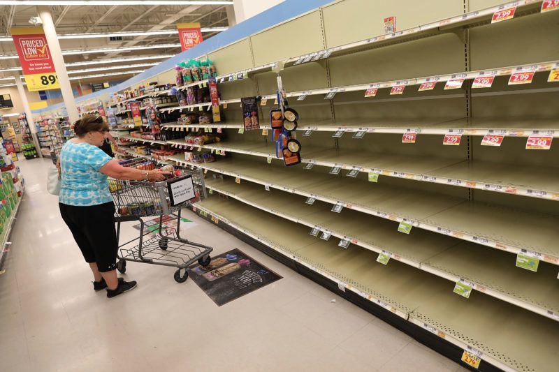 MYRTLE BEACH, SC - SEPTEMBER 12: The bread shelves are bare in a grocery store as people stock up on food ahead of the arrival of Hurricane Florence on September 12, 2018 in Myrtle Beach, South Carolina. Florence slowed its approach to the U.S. today and was expected to turn south, stalling along the North Carolina and South Carolina coast and bringing with it torrential rain, high winds and a dangerous storm surge tomorrow through Saturday.   Joe Raedle/Getty Images/AFP