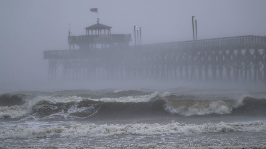 NORTH MYRTLE BEACH, SC - SEPTEMBER 14: Waves created by Hurricane Florence are seen along Cherry Grove Fishing Pier on September 14, 2018 in North Myrtle Beach, United States. Hurricane Florence is hitting along the North Carolina and South Carolina coastline bringing high winds and rain.   Joe Raedle/Getty Images/AFP