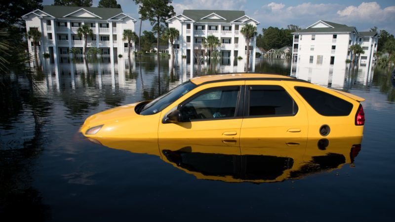 LONGS, SC - SEPTEMBER 20: A car is inundated with floodwaters caused by Hurricane Florence at an apartment complex at Aberdeen Country Club on September 20, 2018 in Longs, South Carolina. Floodwaters are expected to rise through the weekend in the area.   Sean Rayford/Getty Images/AFP