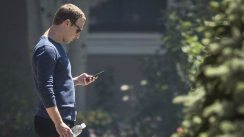 SUN VALLEY, ID - JULY 13: Mark Zuckerberg, chief executive officer of Facebook, checks his phone during the annual Allen & Company Sun Valley Conference, July 13, 2018 in Sun Valley, Idaho. Every July, some of the world's most wealthy and powerful businesspeople from the media, finance, technology and political spheres converge at the Sun Valley Resort for the exclusive weeklong conference.   Drew Angerer/Getty Images/AFP