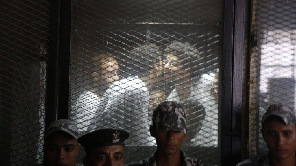 Egyptian photojournalist Mahmoud Abu Zied, known by his nickname Shawkan, gestures in a soundproof glass cage inside a makeshift courtroom in Tora prison in Cairo, Egypt, Saturday, September 8, 2018. After being sentenced to five years in prison and he already spent more then this period Which meant his release. Shawkan was arrested in August 2013 while taking photographs of the government's violent dispersal of a sit-in by supporters of ousted Islamist President Mohammed Morsi (Photo by Islam Safwat/NurPhoto)
