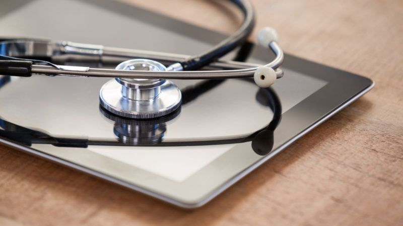 Close-up of stethoscope on digital tablet  in clinic