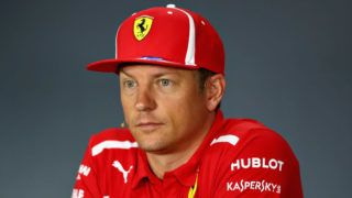 SINGAPORE - SEPTEMBER 13:  Kimi Raikkonen of Finland and Ferrari looks on in the Drivers Press Conference during previews ahead of the Formula One Grand Prix of Singapore at Marina Bay Street Circuit on September 13, 2018 in Singapore.  (Photo by Lars Baron/Getty Images)