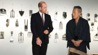 LONDON, ENGLAND - SEPTEMBER 13:  Prince William, Duke of Cambridge meets Head of Copperwear Workshop, Motoyuki Tamagawa (R) during The Official Opening of Japan House London, the new Cultural Home of Japan in the UK on September 13, 2018 in London, England.  (Photo by Tim P. Whitby - WPA Pool/Getty Images)