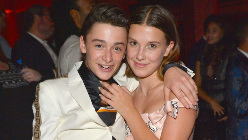LOS ANGELES, CA - SEPTEMBER 17: Noah Schnapp (L) and Millie Bobby Brown attend the 2018 Netflix Primetime Emmys After Party at NeueHouse Hollywood on September 17, 2018 in Los Angeles, California.  (Photo by Donato Sardella/Getty Images for Netflix)