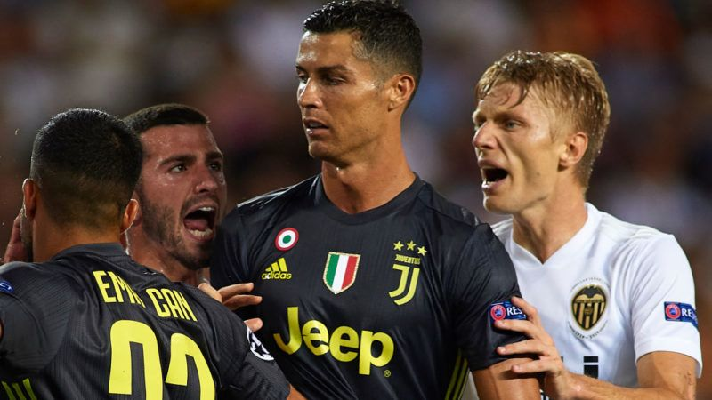VALENCIA, SPAIN - SEPTEMBER 19:  Jose Luis Gaya and Daniel Wass of Valencia argue to Cristano Ronaldo of Juventus during the Group H match of the UEFA Champions League between Valencia and Juventus at Estadio Mestalla on September 19, 2018 in Valencia, Spain.  (Photo by Manuel Queimadelos Alonso/Getty Images)
