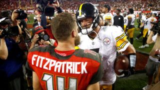 TAMPA, FL - SEPTEMBER 24:  Quarterback Ryan Fitzpatrick #14 of the Tampa Bay Buccaneers and quarterback Ben Roethlisberger #7 of the Pittsburgh Steelers meet up on the field following the Steelers' 30-27 win over the Buccaneers on September 24, 2018 at Raymond James Stadium in Tampa, Florida.  (Photo by Brian Blanco/Getty Images)