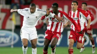 ATHENS, GREECE - DECEMBER 6:  Yaya Toure #15 of Olympiakos fights with Cesar Julio Baptista #8 of Real Madrid for control of the ball during the UEFA Champions League match between Olympiakos and Real Madrid on December 06, 2005 at Karaiskaki stadium in Athens, Greece.  (Photo by Milos Bicanski/Getty Images)