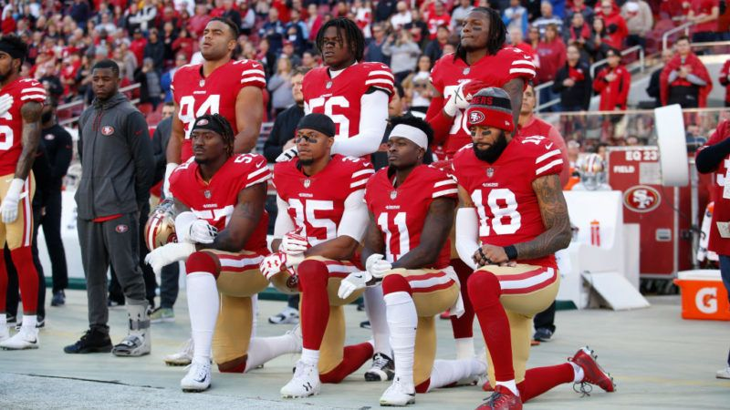 SANTA CLARA, CA - DECEMBER 17: Eli Harold #57, Eric Reid #35, Marquise Goodwin #11 and Louis Murphy #18 of the San Francisco 49ers kneel on the sideline during the anthem as Solomon Thomas #94, Reuben Foster #56 and Adrian Colbert #38 stand with them in support, prior to the game against the Tennessee Titans at Levi's Stadium on December 17, 2017 in Santa Clara, California. The 49ers defeated the Titans 25-23. (Photo by Michael Zagaris/San Francisco 49ers/Getty Images)