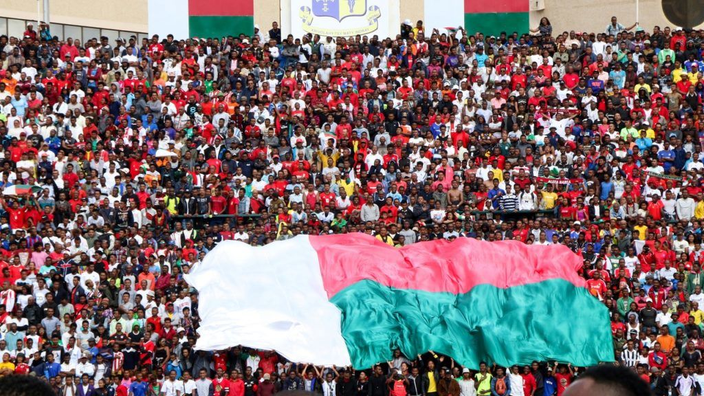 Malagasy supporters cheer during the Africa Cup of Nations 2019 qualifier Madagascar v Senegal on September 9, 2018 in Antananarivo, Madagascar. At least one person was killed and nearly 40 were injured in a stampede ahead of an Africa Cup of Nations qualifier Sunday in which Madagascar hit back twice to draw 2-2 with Senegal. / AFP PHOTO / Mamyrael