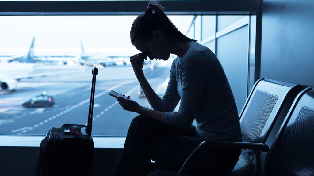 Stressed woman in the airport.