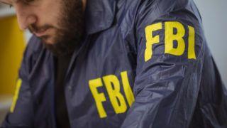 FBI man agent working in office alone