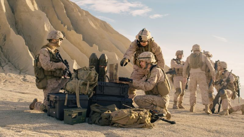 Soldiers are Using Laptop Computer for Surveillance During Military Operation in the Desert.