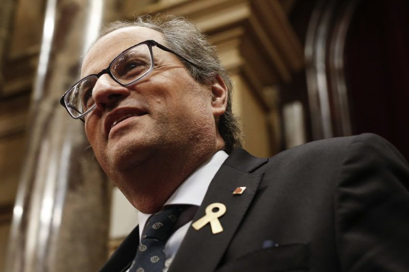 """Catalan regional president Quim Torra arrives to attend the first session of the Catalan regional parliament after the summer break, in Barcelona, on October 2, 2018. Catalonia's separatist executive was today accused of playing a """"dangerous"""" game after the regional leader encouraged radical independence activists to carry out disruptive acts on the anniversary of a banned referendum that culminated in clashes. Hundreds of pro-independence protesters knocked down barriers at the entrance of the regional parliament late yesterday evening, provoking clashes with police and forcing the leader in Catalonia of anti-secession party Ciudadanos to leave the building under escort. / AFP PHOTO / PAU BARRENA"""