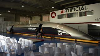A full-scale passenger Hyperloop capsule is presented by Hyperloop Transportation Technologies on October 2, 2018 in El Puerto de Santa Maria.    A hyperloop is a shuttle that travels on magnetic rails, somewhat like a train, but which runs in a tube with little or no air. In theory, hyperloops could allow travel faster than the speed of sound. Virgin Hyperloop One, backed by British tycoon Richard Branson, has been testing its hyperloop system in Nevada in the United States with speeds reaching 240 miles (386 kilometres) an hour, and is planning three production systems in service by 2021. / AFP PHOTO / CRISTINA QUICLER