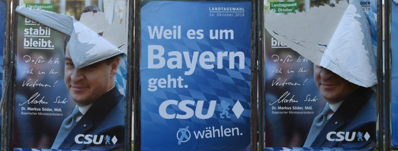 Destroyed election posters of Bavaria's State Premier and top candidate of the conservative Christian Social Union (CSU) party for the regional elections in Bavaria, Markus Soeder,  can be seen in Munich, southern Germany, on October 10, 2018. - The regional election in Bavaria will take place on October 14, 2018. (Photo by Christof STACHE / AFP)