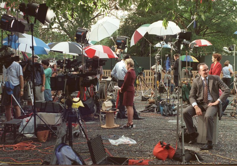 The area where television reporters deliver the news just inside the gates of the White House in Washington, DC, appears more like a junk yard than the front yard with the clutter of equipment 17 August as US President Bill Clinton testifies before Kenneth Starr's grand jury about his relationship with former White House intern Monica Lewinsky.   AFP PHOTO   Paul J.  RICHARDS (Photo by PAUL J. RICHARDS / AFP)