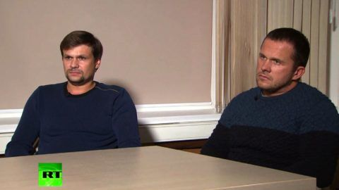 """A screengrab taken on September 13, 2018, from footage broadcast by Russia's state broadcaster Russia Today (RT), shows two men, purported to be Alexander Petrov and Ruslan Boshirov taking part in a television interview. Two men accused by London of poisoning former spy Sergei Skripal told Russian media on Thursday they visited the British city of Salisbury for tourist purposes and denied having anything to do with the murder attempt.  / AFP PHOTO / RUSSIA TODAY / HO / RESTRICTED TO EDITORIAL USE - MANDATORY CREDIT  """" AFP PHOTO / RUSSIA TODAY (RT)""""  -  NO MARKETING NO ADVERTISING CAMPAIGNS   -   DISTRIBUTED AS A SERVICE TO CLIENTS - NO ARCHIVES - NO USE AFTER 30 DAYS FROM SEPTEMBER 30"""