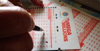 Numbers are selected on a Mega Millions lottery ticket in Los Angeles, California on October 23, 2018. - The Mega Millions jackpot, now reaching 1.6 billion USD, will be drawn on tonight. (Photo by Frederic J. BROWN / AFP)