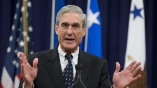 (FILES) In this file photo taken on August 1, 2013, Federal Bureau of Investigation (FBI) Director Robert Mueller speaks during a farewell ceremony in Mueller's honor at the Department of Justice. - The FBI is investigating an alleged scheme to pay women to smear Russia collusion probe head Robert Mueller with sexual harassment allegations, Mueller's office said on October 30, 2018. The scheme was uncovered after one woman who said she worked for Mueller decades ago told several journalists she had been offered $20,000 to accuse him of sexual misconduct. (Photo by Saul LOEB / AFP)