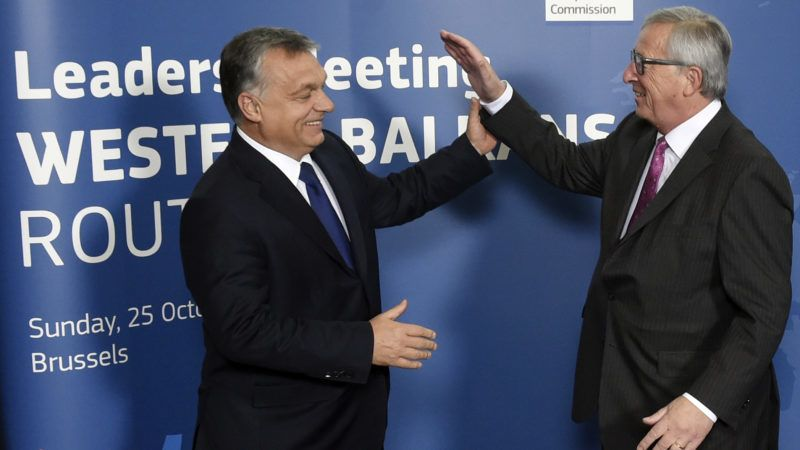 EU Commission President Jean Claude Juncker (R) welcomes Hungary Prime minister Viktor Orban prior to an European leader's meeting on refugee flows along the Western Balkans route at the European Commission in Brussels on October 25, 2015. European Union and Balkan leaders faced a make-or-break summit today on the deepening refugee crisis after three frontline states threatened to close their borders if their EU peers stopped accepting migrants.   AFP PHOTO / JOHN THYS (Photo by JOHN THYS / AFP)