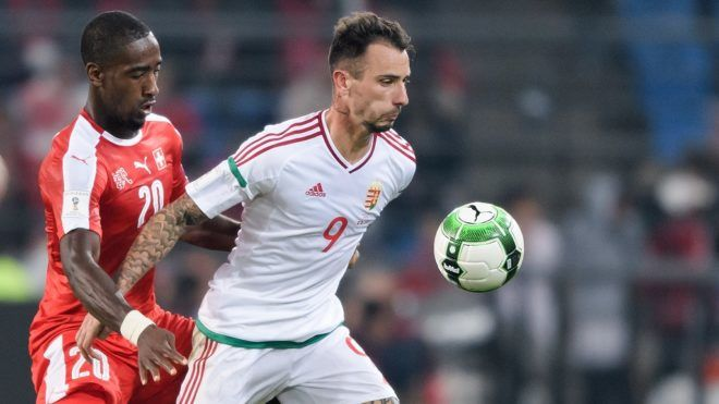 Swiss defender Johan Djourou (L) and Hungarian forward Roland Ugrai vie for the ball during the FIFA World Cup WC 2018 football qualifier match between Switzerland and Hungary at the St Jakob-Park Stadium on October 7, 2017 in Basel. (Photo by Fabrice COFFRINI / AFP)