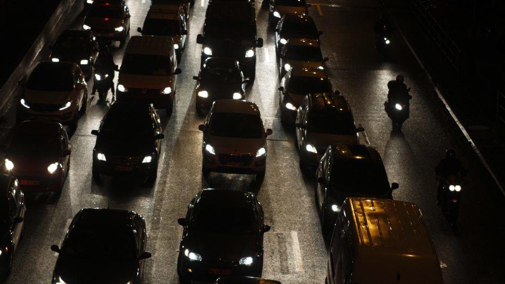 France, Paris at night, under rain with  traffic jam