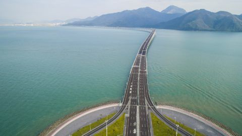 (181022) -- HONG KONG, Oct. 22, 2018 (Xinhua) -- Aerail photo taken on Oct. 13, 2018 shows the Hong Kong section of the Hong Kong-Zhuhai-Macao Bridge in Hong Kong, south China. The Hong Kong-Zhuhai-Macao Bridge is to be officially open to traffic on Oct. 24, further integrating cities in the Pearl River Delta.  (Xinhua/Lui Siu Wai) (gxn)