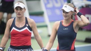 (180927) -- WUHAN, Sept. 27, 2018 (Xinhua) -- Timea Babos (L) of Hungary and Kristina Mladenovic of France react during doubles quarterfinal match against Shuko Aoyama of Japan and Lidziya Marozava of Russia at the 2018 WTA Wuhan Open tennis tournament in Wuhan of central China's Hubei Province, on Sept. 27, 2018. Shuko Aoyama and Lidziya Marozava won 2-0. (Xinhua/Xiao Yijiu)