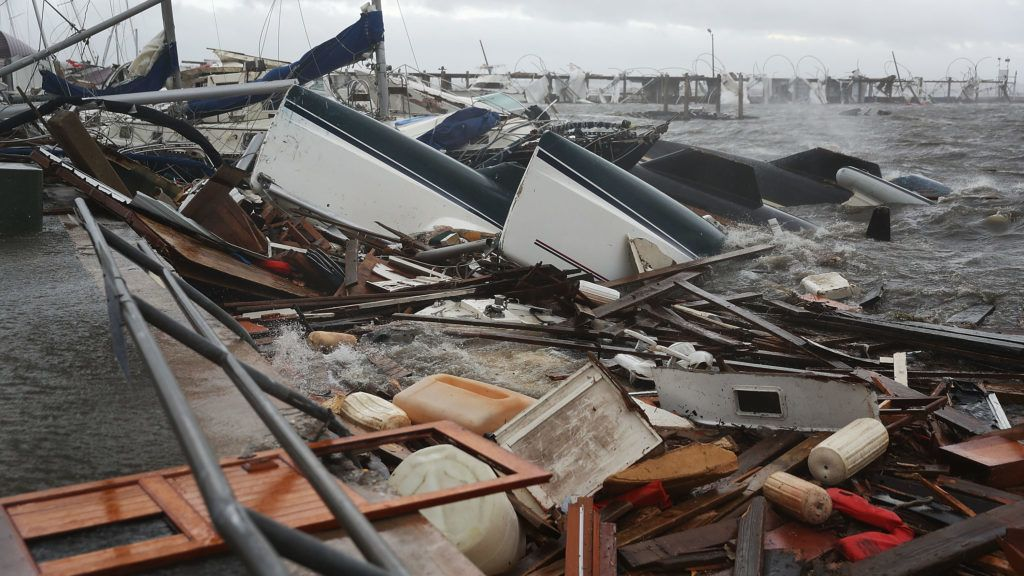 PANAMA CITY, FL - OCTOBER 10: Boats that were docked are seen in a pile of rubble after hurricane Michael passed through the downtown area on October 10, 2018 in Panama City, Florida. The hurricane hit the Florida Panhandle as a category 4 storm.   Joe Raedle/Getty Images/AFP