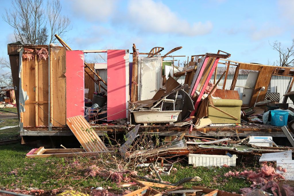 PANAMA CITY, FL - OCTOBER 11: Debris is strewn next to a mobile home destroyed by Hurricane Michael on October 11, 2018 in Panama City, Florida. The hurricane hit the Florida Panhandle as a category 4 storm.   Joe Raedle/Getty Images/AFP