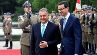 """BUDAPEST, HUNGARY - MAY 14 : (----EDITORIAL USE ONLY – MANDATORY CREDIT - """"HUNGARIAN PRIME MINISTRY PRESS OFFICE"""" - NO MARKETING NO ADVERTISING CAMPAIGNS - DISTRUBUTED AS A SERVICE TO CLIENTS----) Prime Minister of Hungary Viktor Orban (2nd L) and Prime Minister of Poland Mateusz Morawiecki (3rd L) walk past honor guards during an official welcoming ceremony in Budapest, Hungary on May 14, 2018.   Hungarian Prime Ministry Press Office/ Handout / Anadolu Agency"""
