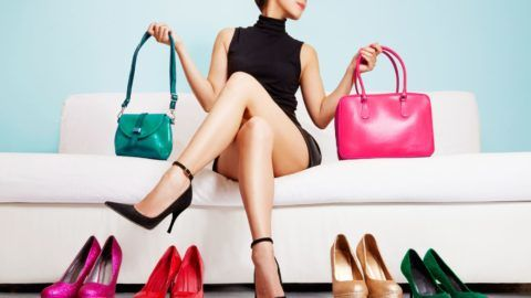Beautiful legs woman sitting on the white sofa with many fashion items.