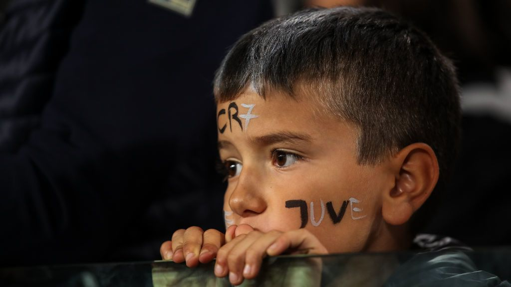 TURIN, ITALY - SEPTEMBER 26: A young fan of Juventus has CR7 painted on his forehead  during the Serie A match between Juventus and Bologna FC at Allianz Stadium on September 26, 2018 in Turin, Italy. (Photo by Robbie Jay Barratt - AMA/Getty Images)